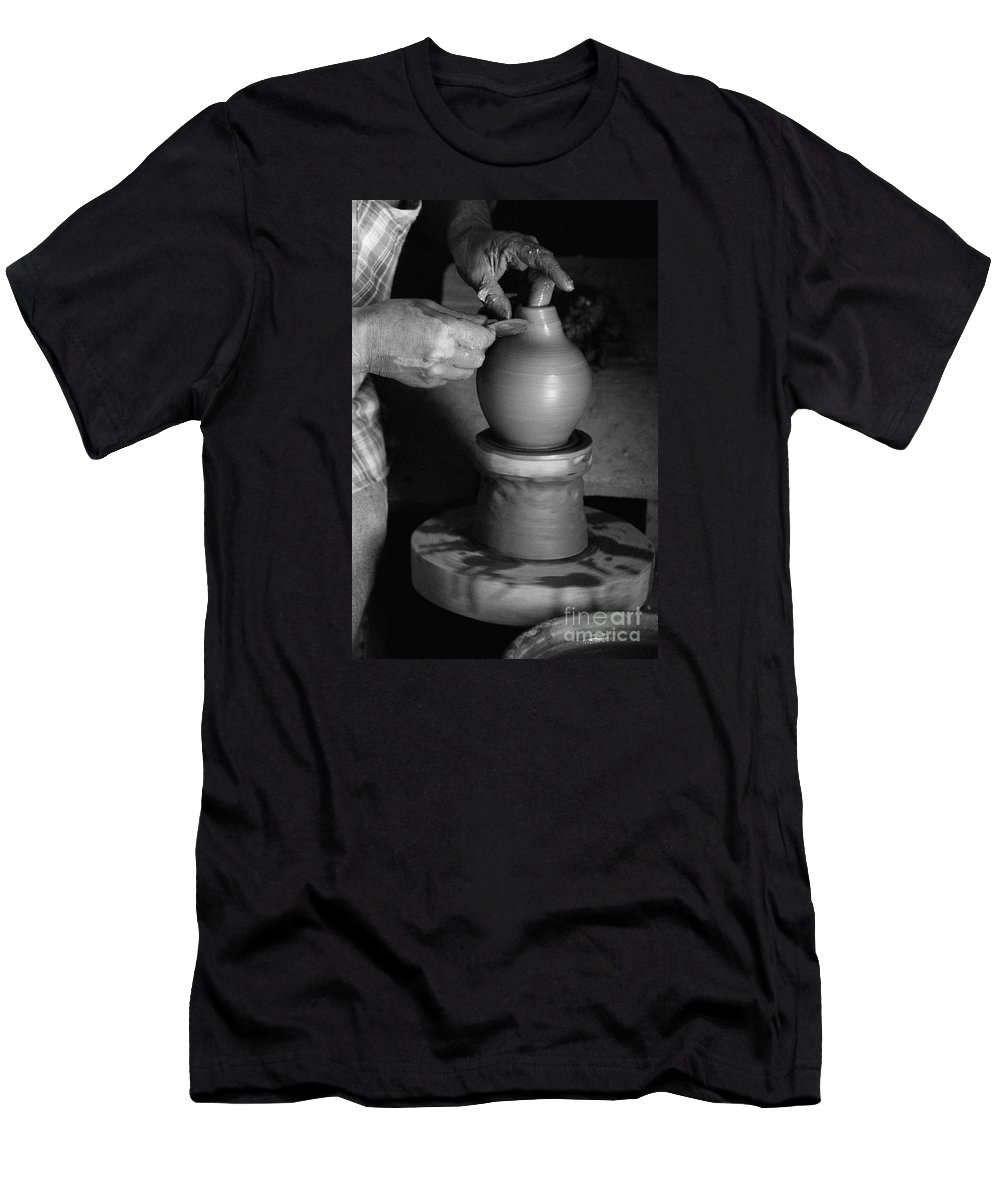 Azores Men's T-Shirt (Athletic Fit) featuring the photograph Potter At Work by Gaspar Avila