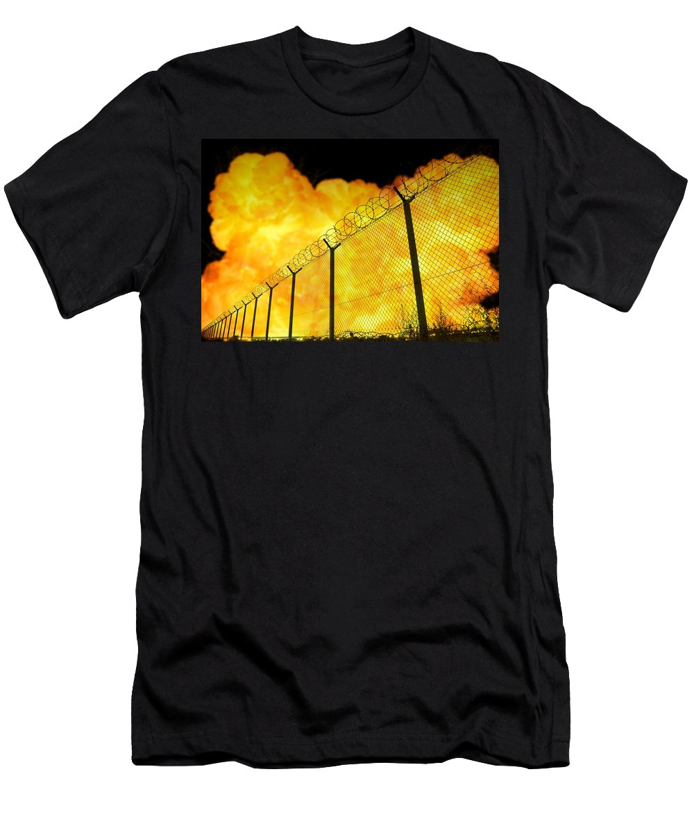 Prison Men's T-Shirt (Athletic Fit) featuring the photograph Realistic Orange Fire Explosion Behind Restricted Area Barbed Wire Fence, Blurred Background by Lukasz Szczepanski
