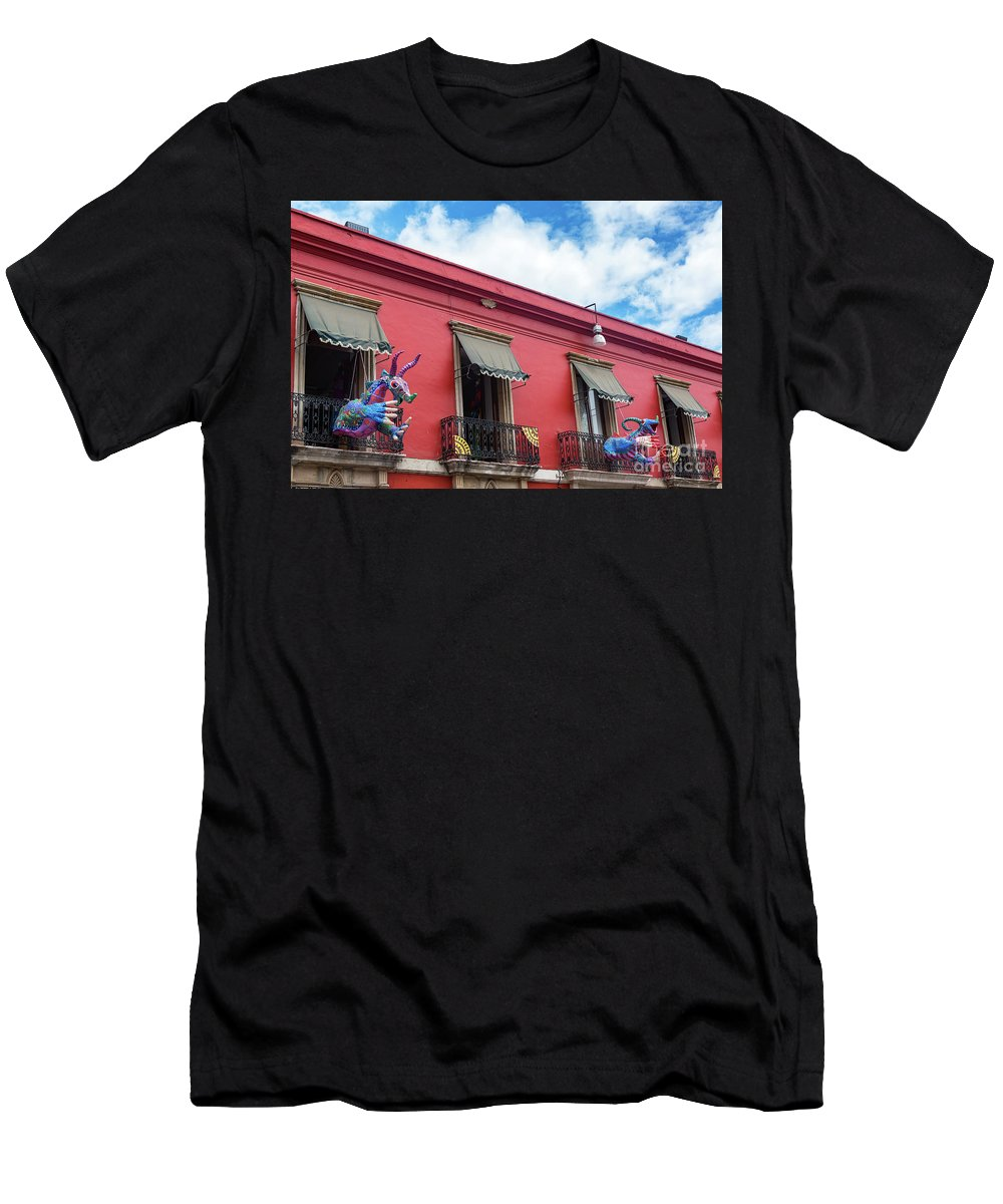 Oaxaca Men's T-Shirt (Athletic Fit) featuring the photograph Red Building And Alebrije by Jess Kraft