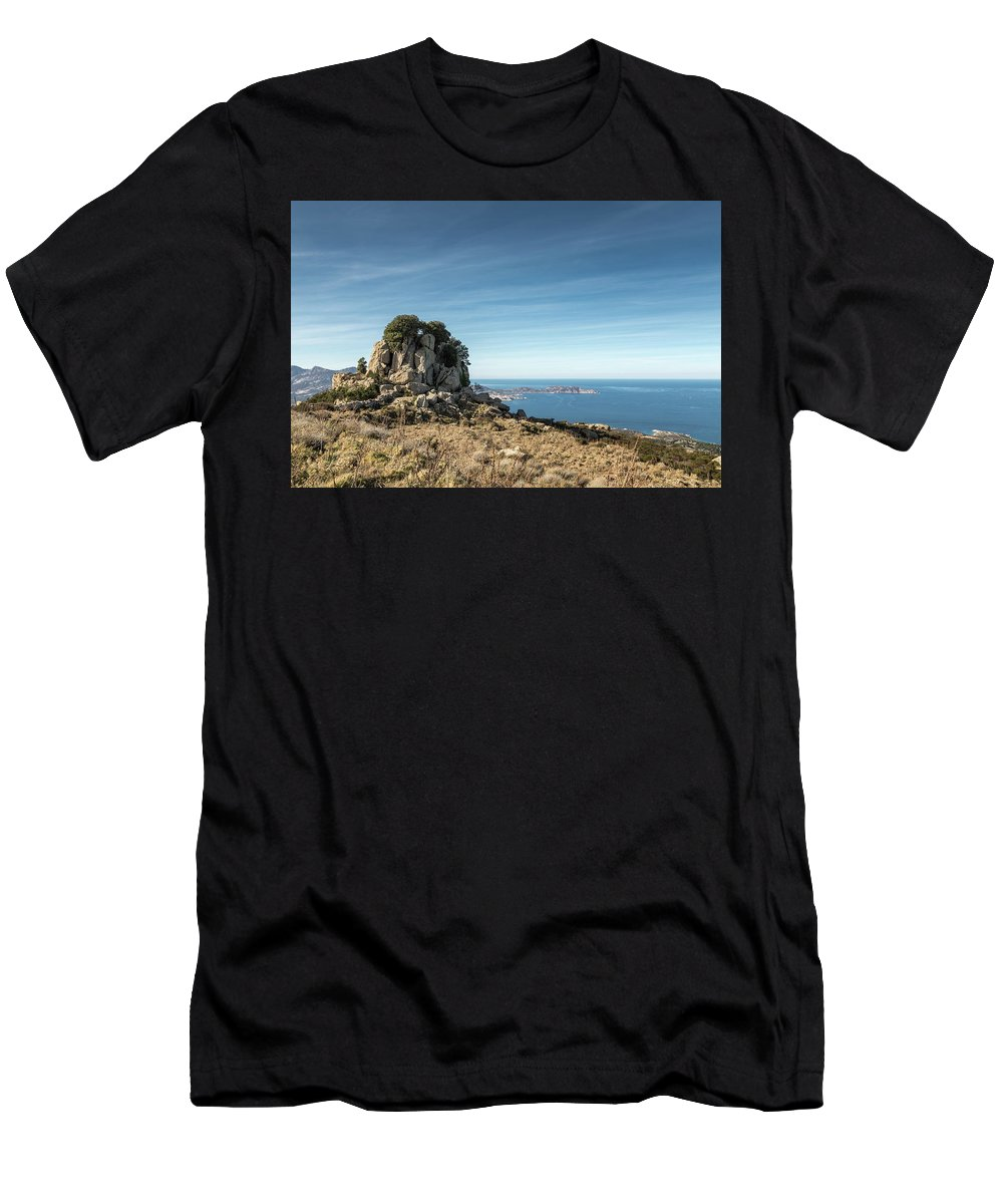 Balagne Men's T-Shirt (Athletic Fit) featuring the photograph Rocky Outcrop Above Calvi Bay In Corsica by Jon Ingall