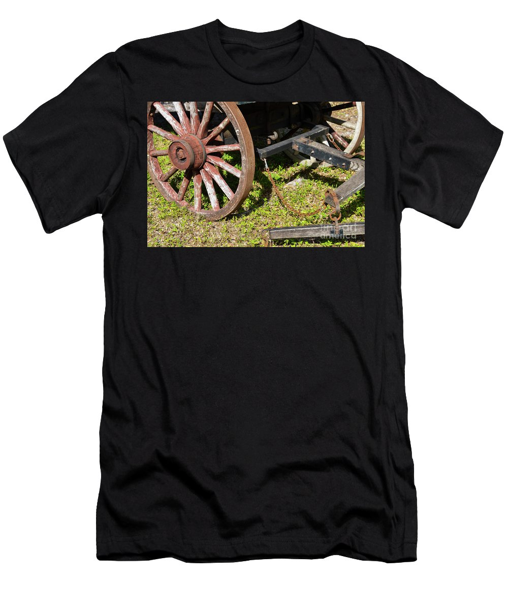 Sanibel Historic Museum And Village Men's T-Shirt (Athletic Fit) featuring the photograph Sanibel Village Wagon Wheels by Bob Phillips