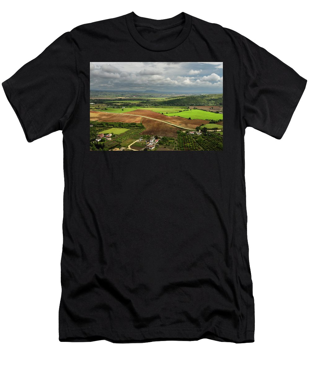 Sunlit Men's T-Shirt (Athletic Fit) featuring the photograph Sunlit Farms And Fields Below Arcos De La Frontera Andalusia Spa by Reimar Gaertner