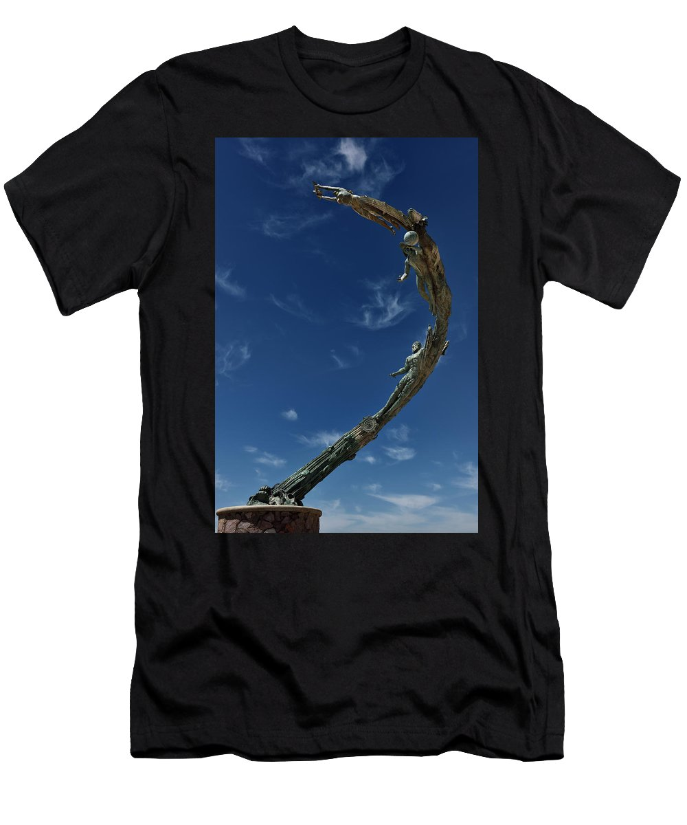Millennia Men's T-Shirt (Athletic Fit) featuring the photograph The Millennia Sculpture Of Evolutionary And Human History On The by Reimar Gaertner