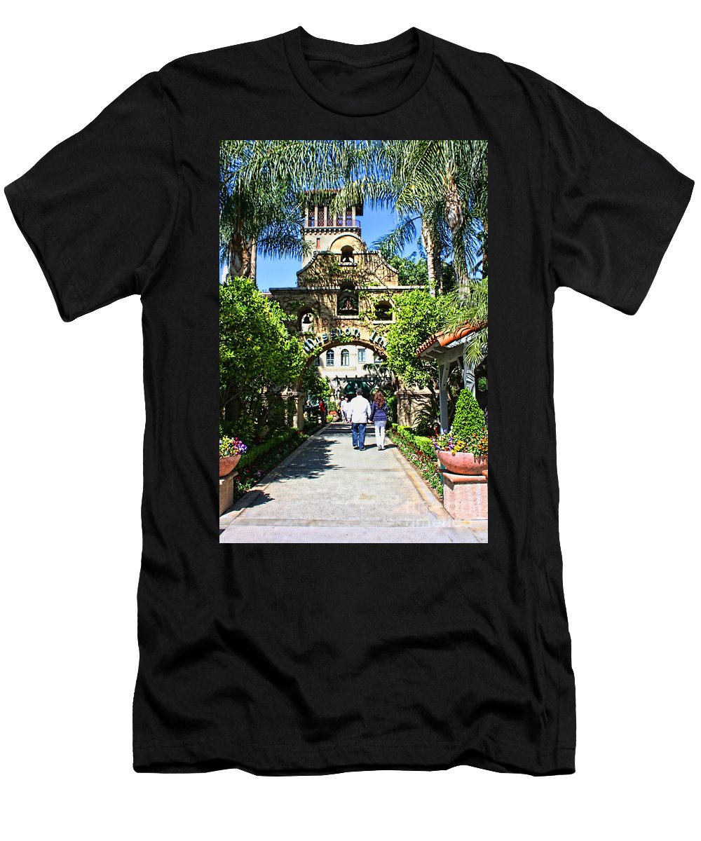 Mission Inn Men's T-Shirt (Athletic Fit) featuring the photograph The Mission Inn Stage Coach Entrance by Tommy Anderson