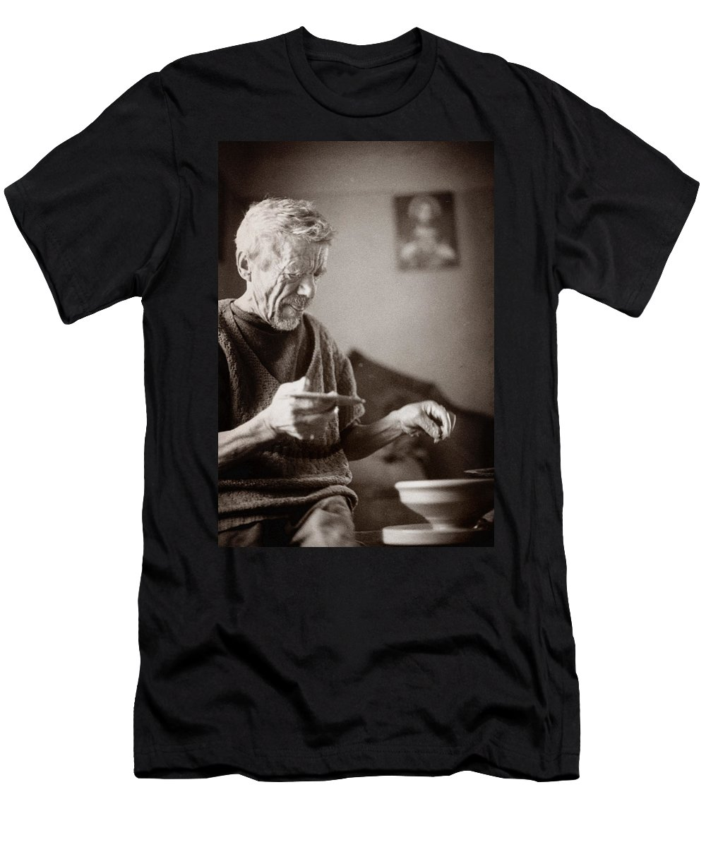 Ukraine Men's T-Shirt (Athletic Fit) featuring the photograph The Potter Of Haweryvschyna by Yuri Lev