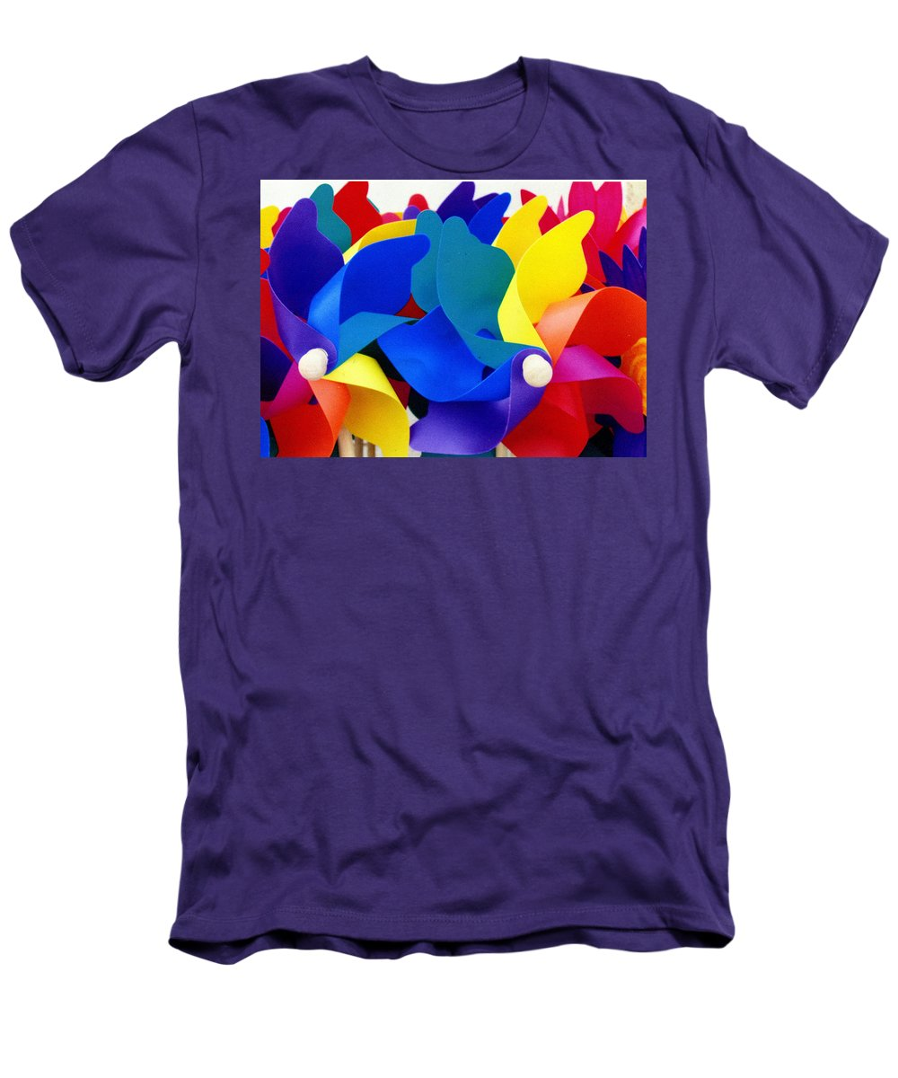 Toy Men's T-Shirt (Athletic Fit) featuring the photograph What Goes Around by Wayne Potrafka