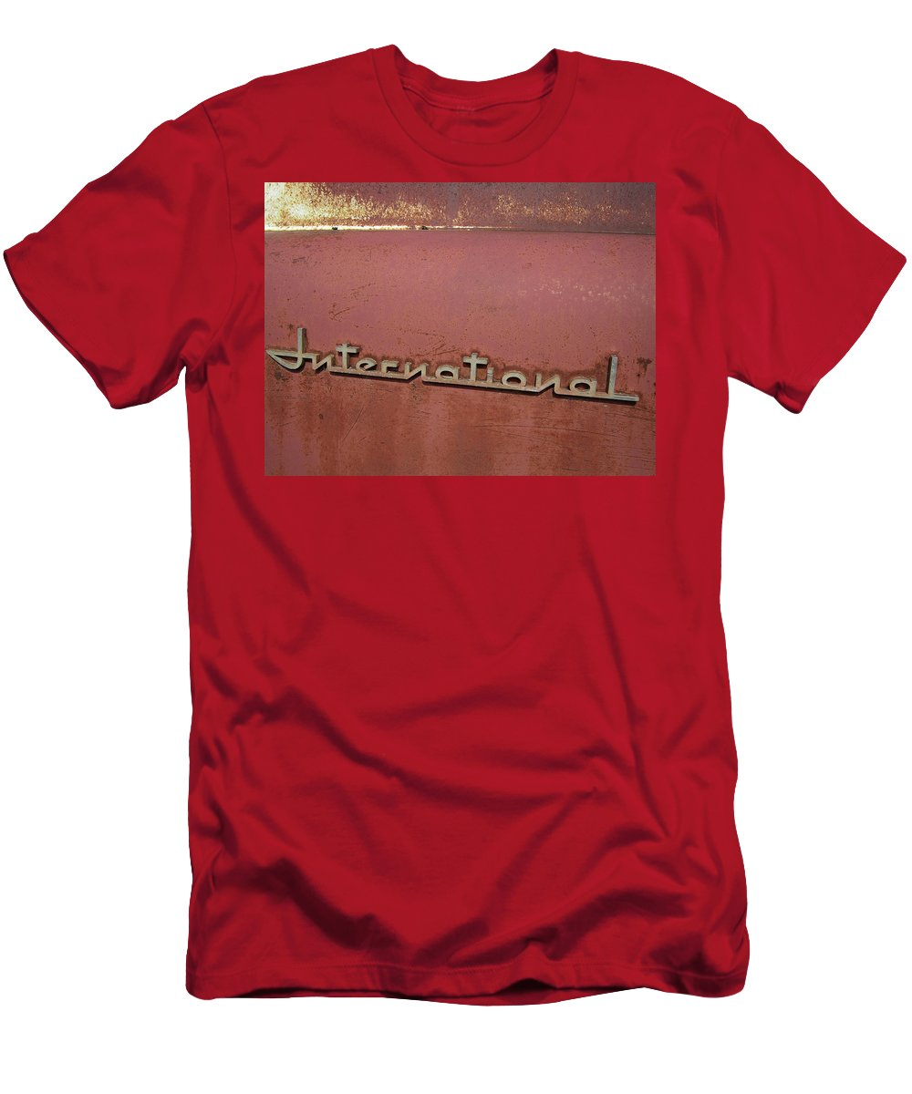 Emblem Men's T-Shirt (Athletic Fit) featuring the photograph 1940s Era International Harvester Truck Insignia by Daniel Hagerman