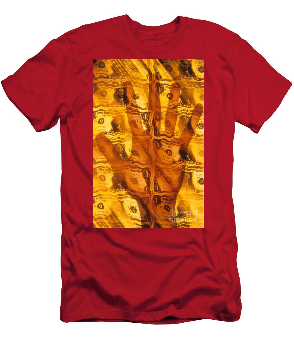 America T-Shirt featuring the photograph Hand Grasping For Dollars by Novastock