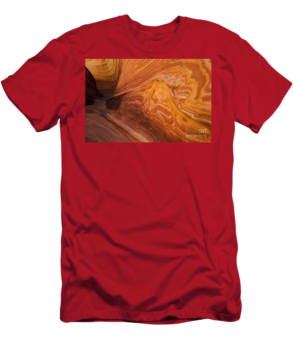 The Wave Men's T-Shirt (Athletic Fit) featuring the photograph Harmony Of Stone And Light 2 by Bob Christopher
