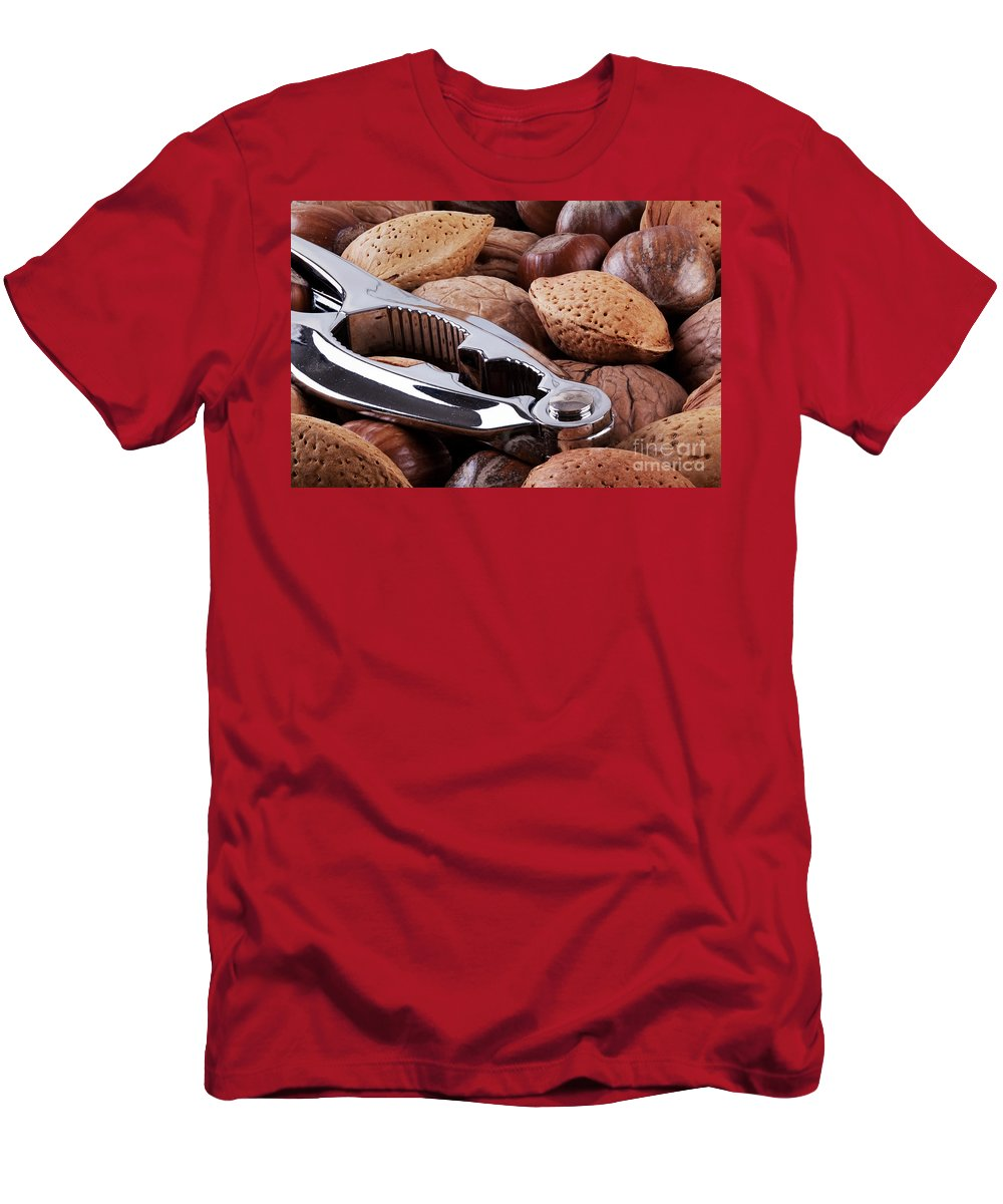 Nuts Men's T-Shirt (Athletic Fit) featuring the photograph Nutcracker And Whole Nuts by Simon Bratt Photography LRPS