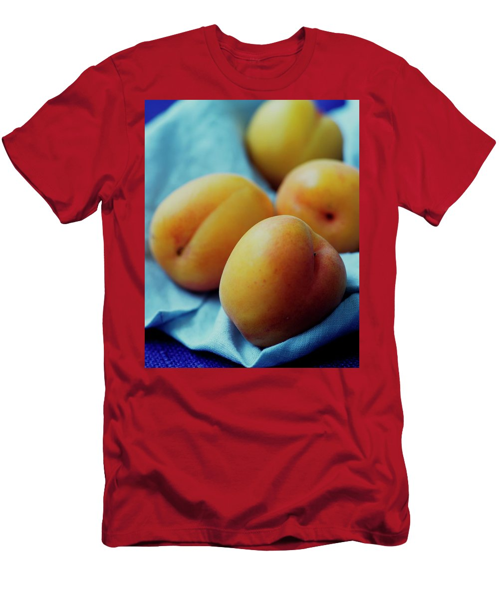 Fruits Men's T-Shirt (Athletic Fit) featuring the photograph Plumcots by Romulo Yanes