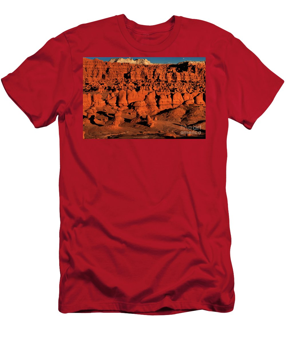 North America Men's T-Shirt (Athletic Fit) featuring the photograph Sunset Light Turns The Hoodoos Blood Red In Goblin Valley State Park Utah by Dave Welling
