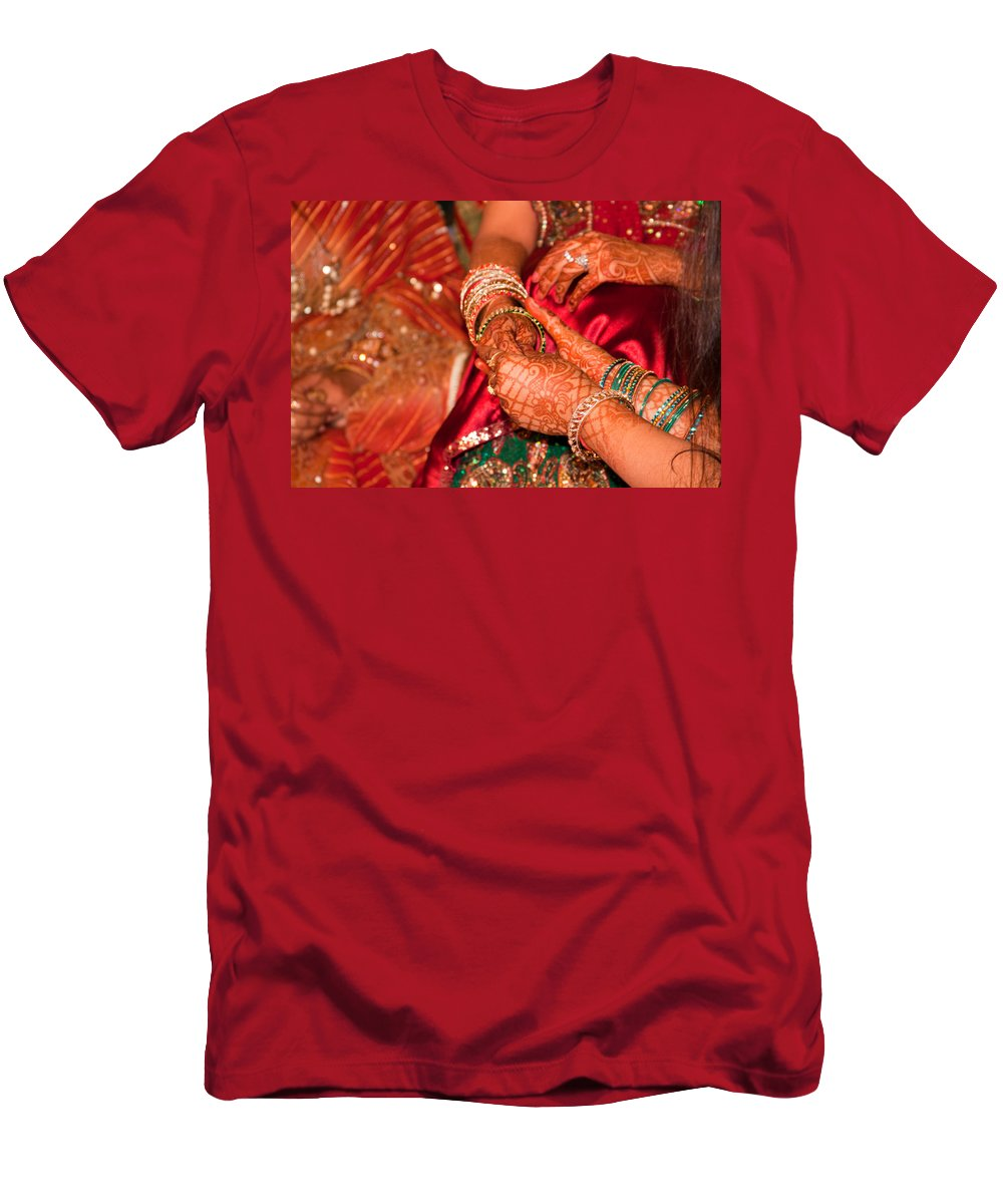 Hindu Men's T-Shirt (Athletic Fit) featuring the photograph Women With Decorated Hands Holding Hands In A Hindu Religious Ceremony by Ashish Agarwal