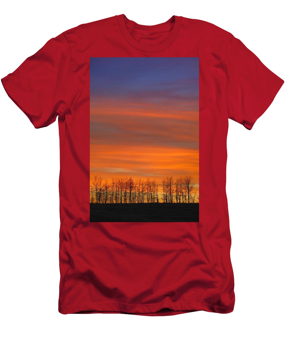 Hope Men's T-Shirt (Athletic Fit) featuring the photograph Silhouette Of Trees Against Sunset by Don Hammond