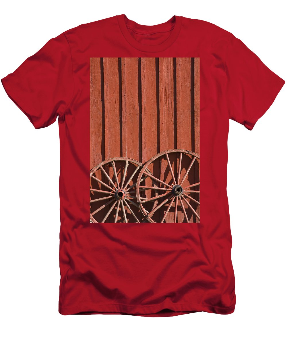Wheel Wheels Wagon Old Red Barn Antique Past History Rural Country Men's T-Shirt (Athletic Fit) featuring the photograph Old Wagon Wheels IIi by Andrei Shliakhau