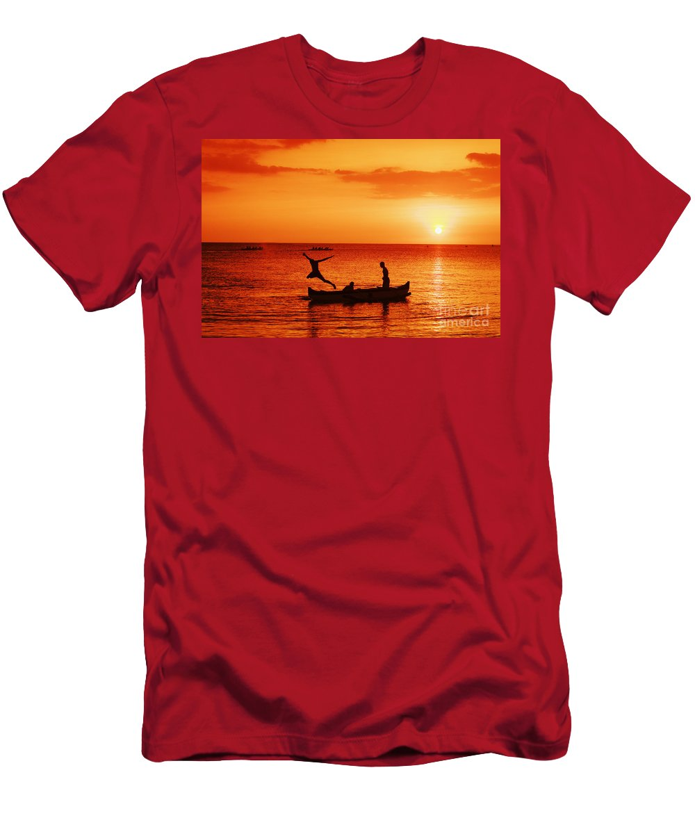 Boat Men's T-Shirt (Athletic Fit) featuring the photograph Sunset Canoe Jump by Vince Cavataio - Printscapes
