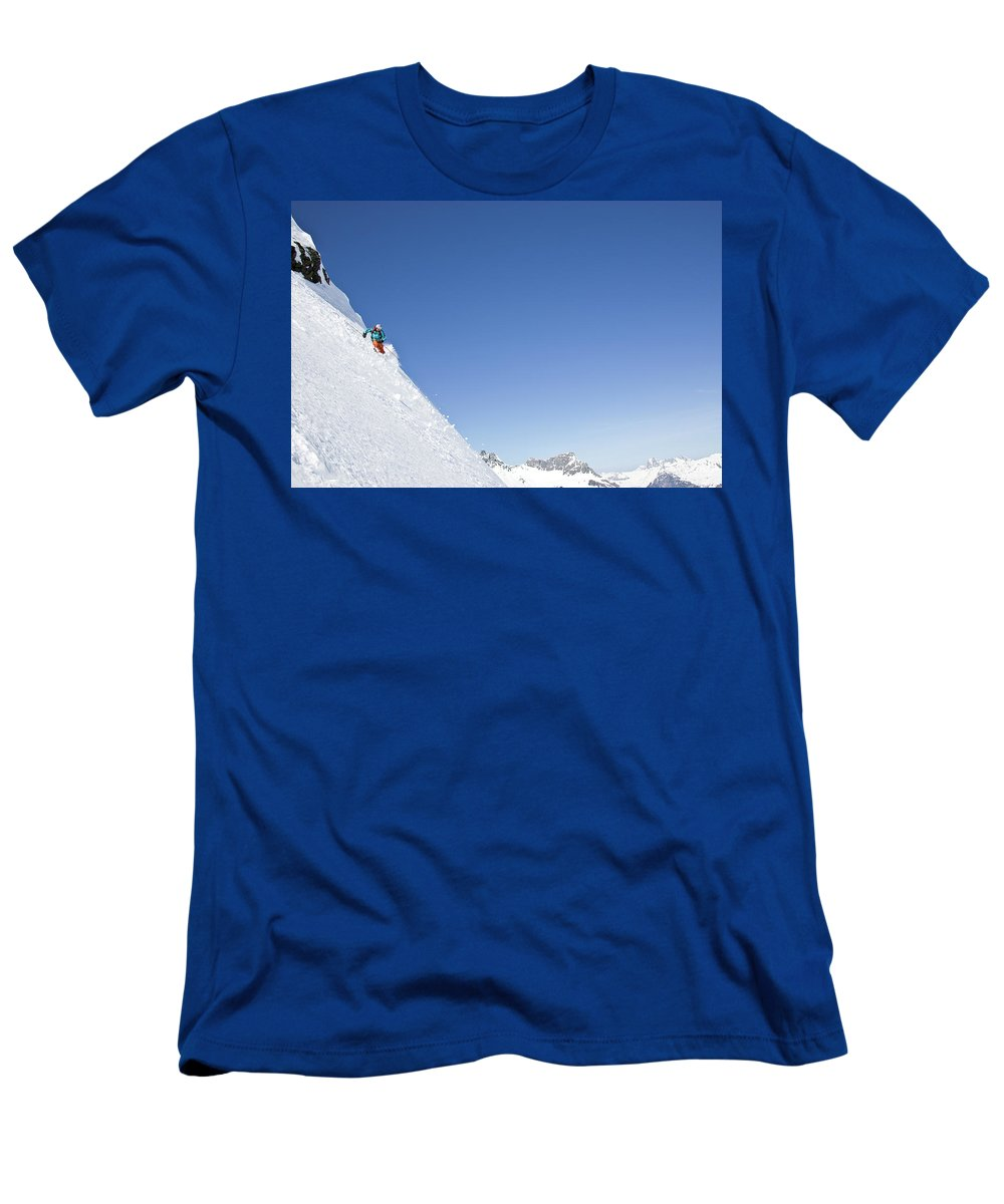 Active Men's T-Shirt (Athletic Fit) featuring the photograph A Young Man Skis Untracked Powder by Henry Georgi