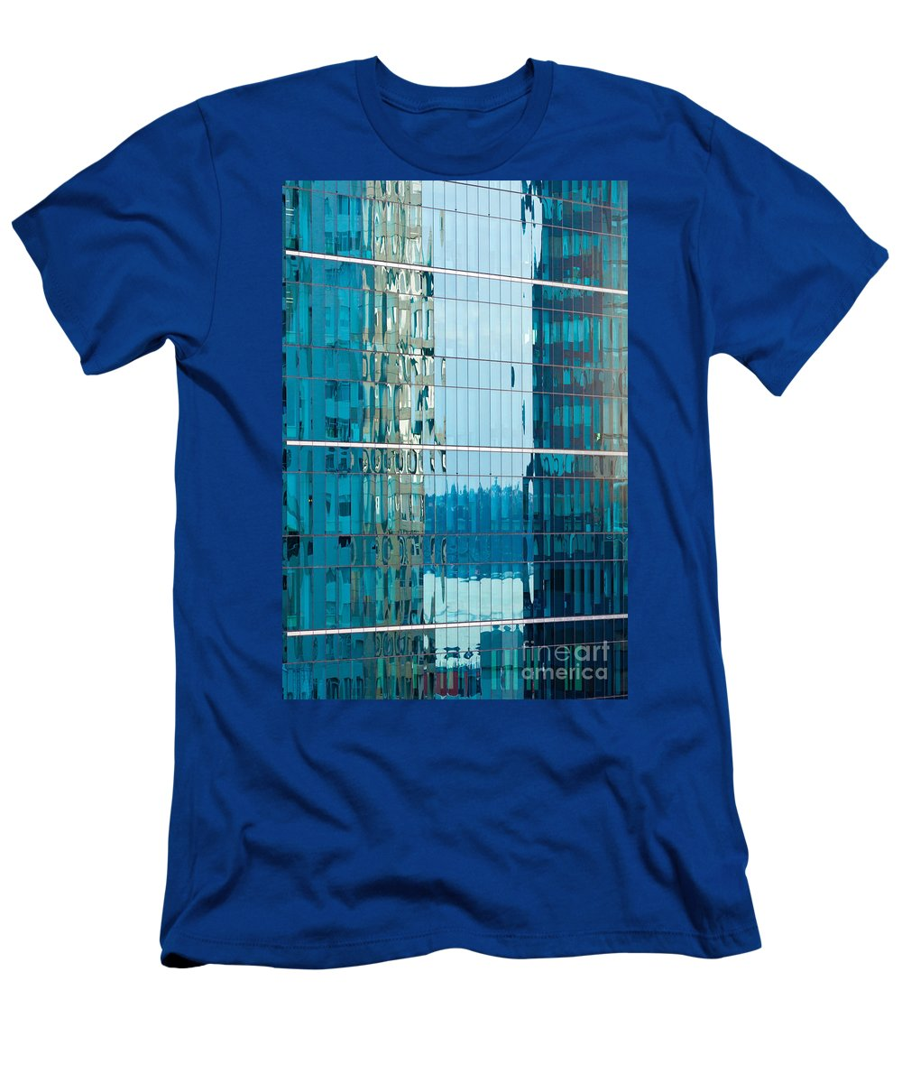 Abstract Men's T-Shirt (Athletic Fit) featuring the photograph Reflections In Modern Glass-walled Building Facade by Stephan Pietzko