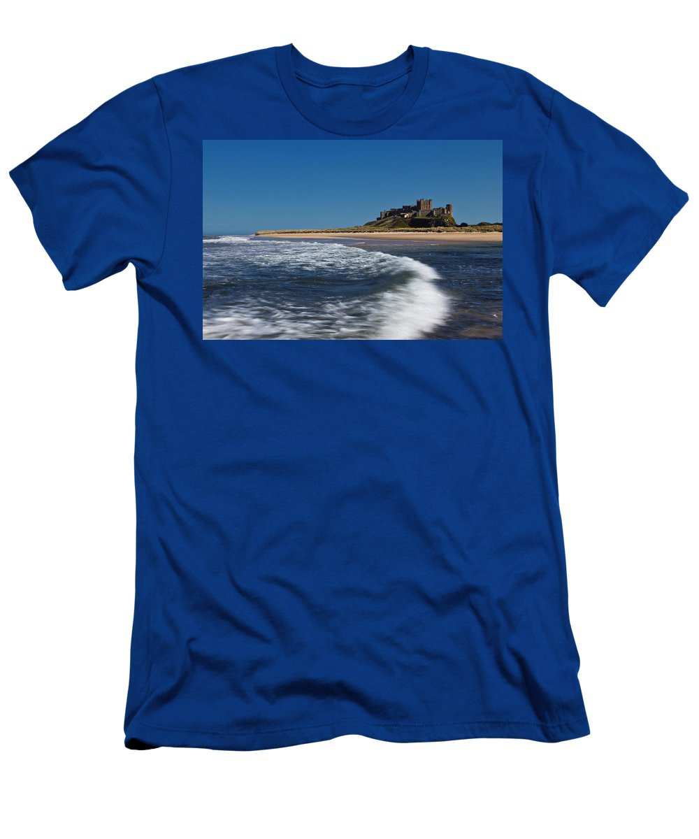 Bamburgh Men's T-Shirt (Athletic Fit) featuring the photograph Bamburgh Castle by David Pringle