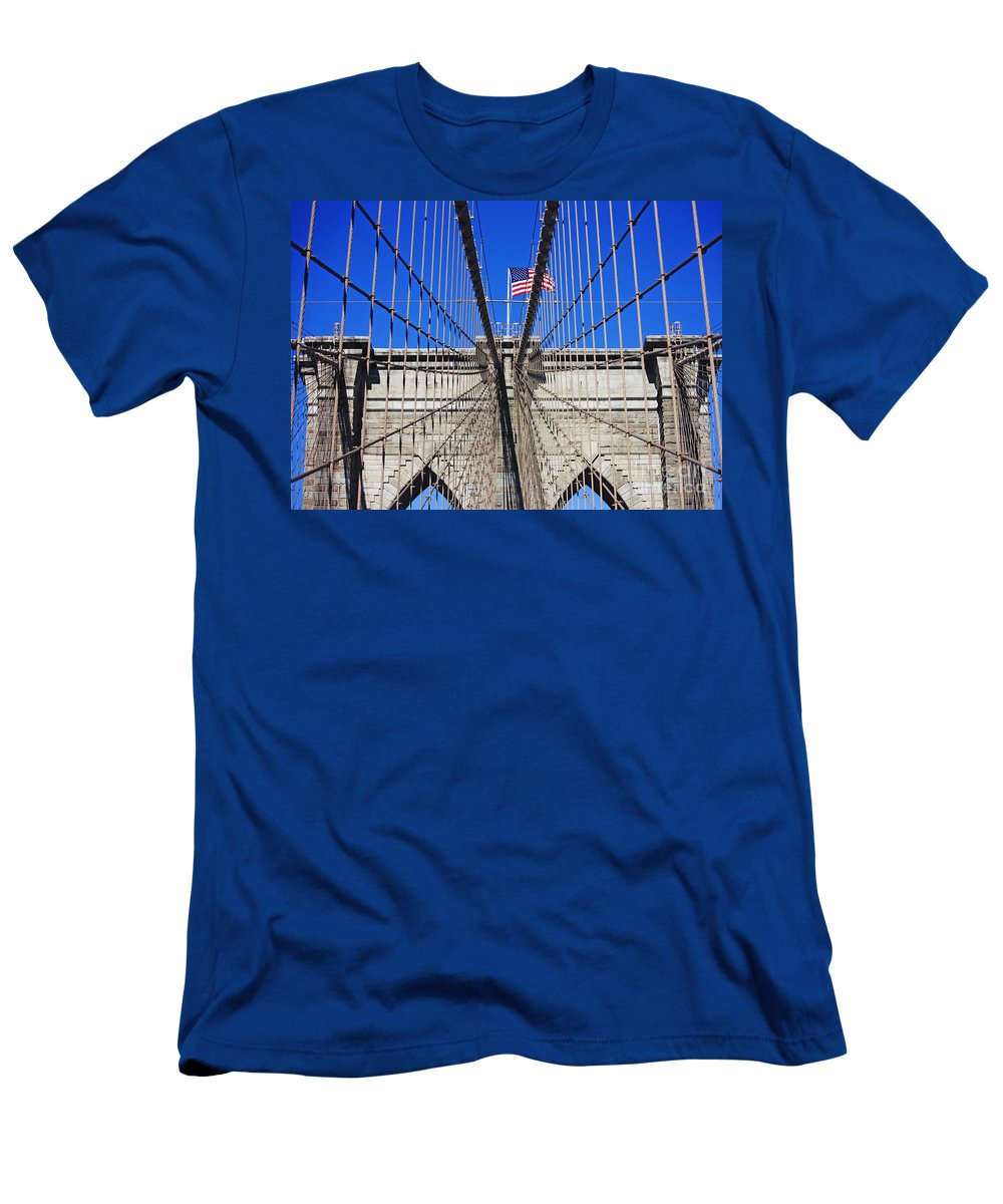 Brooklyn Bridge Men's T-Shirt (Athletic Fit) featuring the photograph Brooklyn Bridge With American Flag by Nishanth Gopinathan