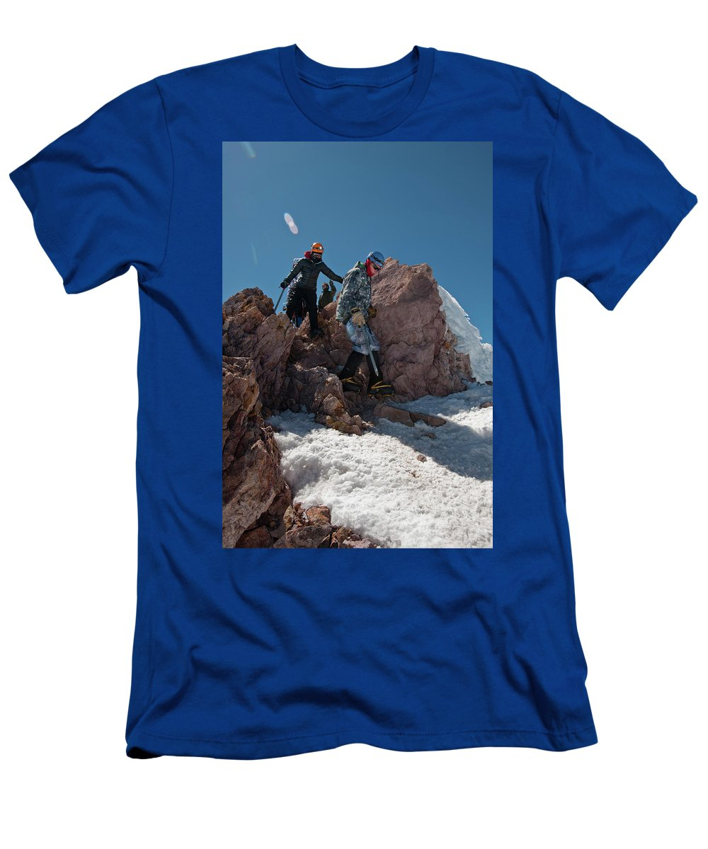 Young Man Men's T-Shirt (Athletic Fit) featuring the photograph Three People Climb Down Rocks by Beth Wald