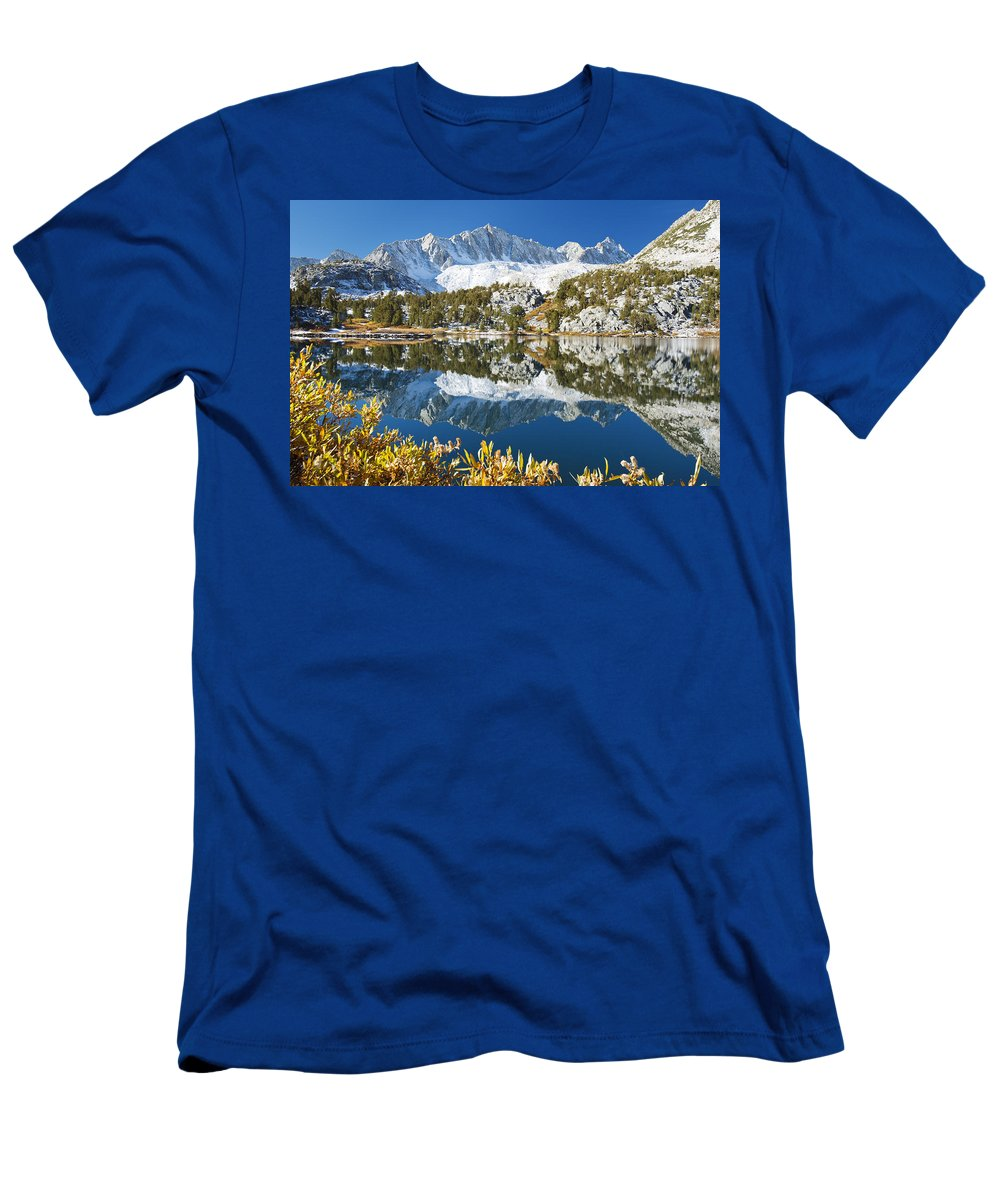 Autumn Men's T-Shirt (Athletic Fit) featuring the photograph Snowy Reflections On Lake by MakenaStockMedia