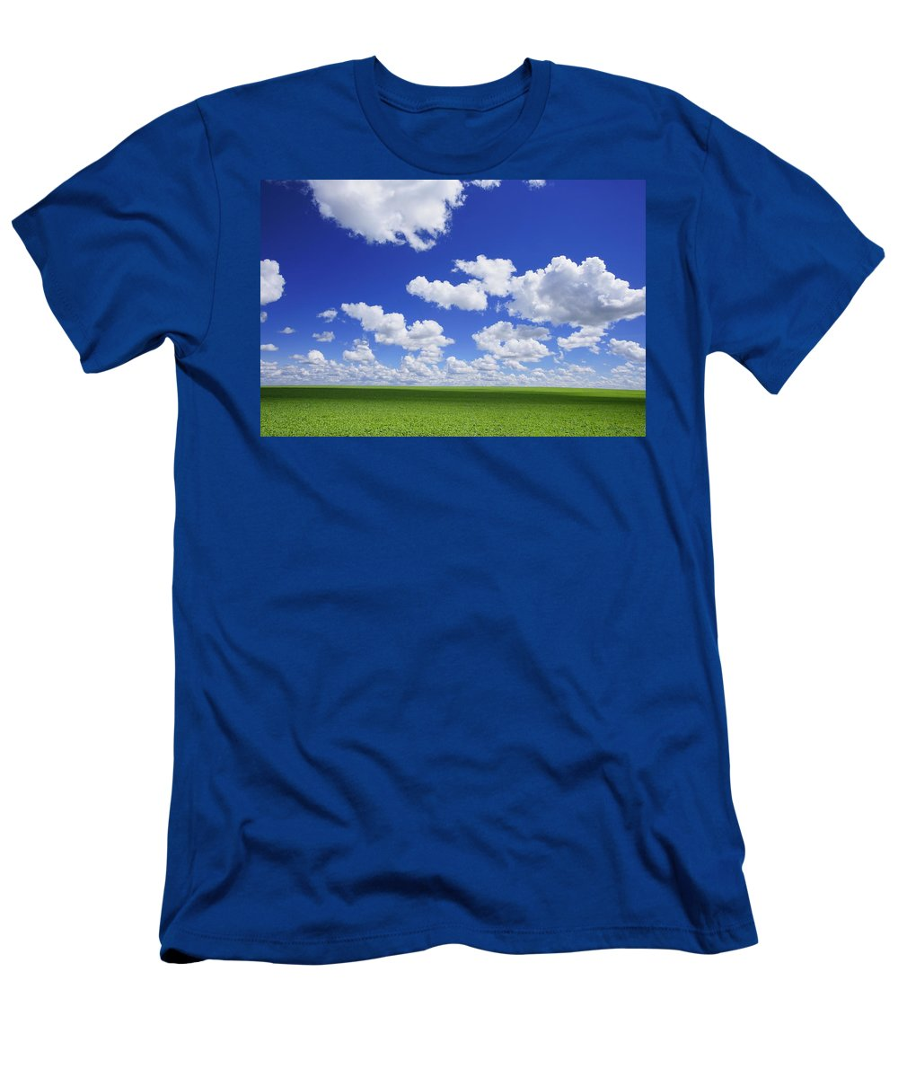 Canada Men's T-Shirt (Athletic Fit) featuring the photograph White Clouds In The Sky And Green Meadow by Don Hammond