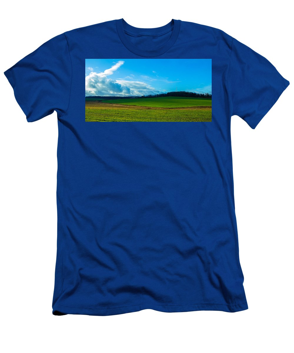 Sky Men's T-Shirt (Athletic Fit) featuring the photograph Green Grass And Blue Sky With White Clouds by Valery Rudnev