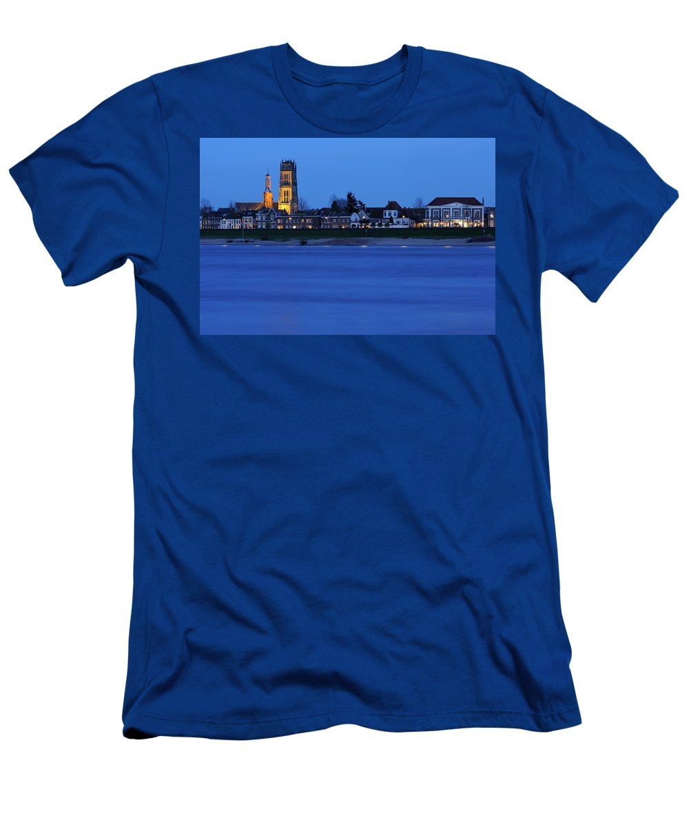 St. Martin's Church Men's T-Shirt (Athletic Fit) featuring the photograph Zaltbommel Skyline Along The Waal River At Dusk by Merijn Van der Vliet