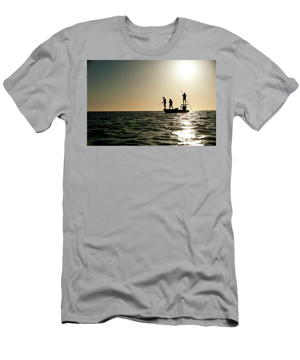 20-24 Years Men's T-Shirt (Athletic Fit) featuring the photograph A Couple Fish As A Man Pilots A Small by Corey Rich