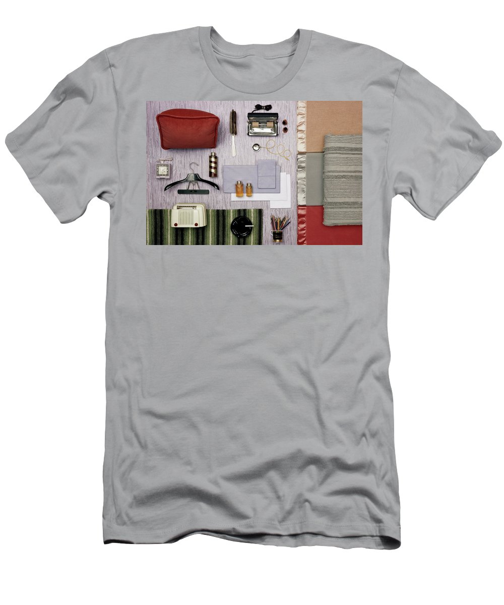 Studio Shot Men's T-Shirt (Athletic Fit) featuring the photograph A Group Of Household Objects by Geoffrey Baker