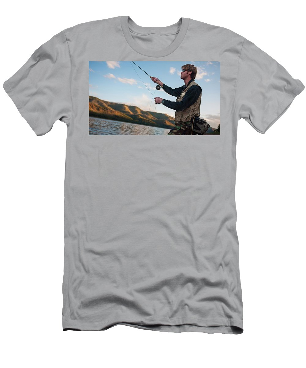 At The Edge Of Men's T-Shirt (Athletic Fit) featuring the photograph A Young Man In His Early Thirties Fly by Jeremy Wade Shockley