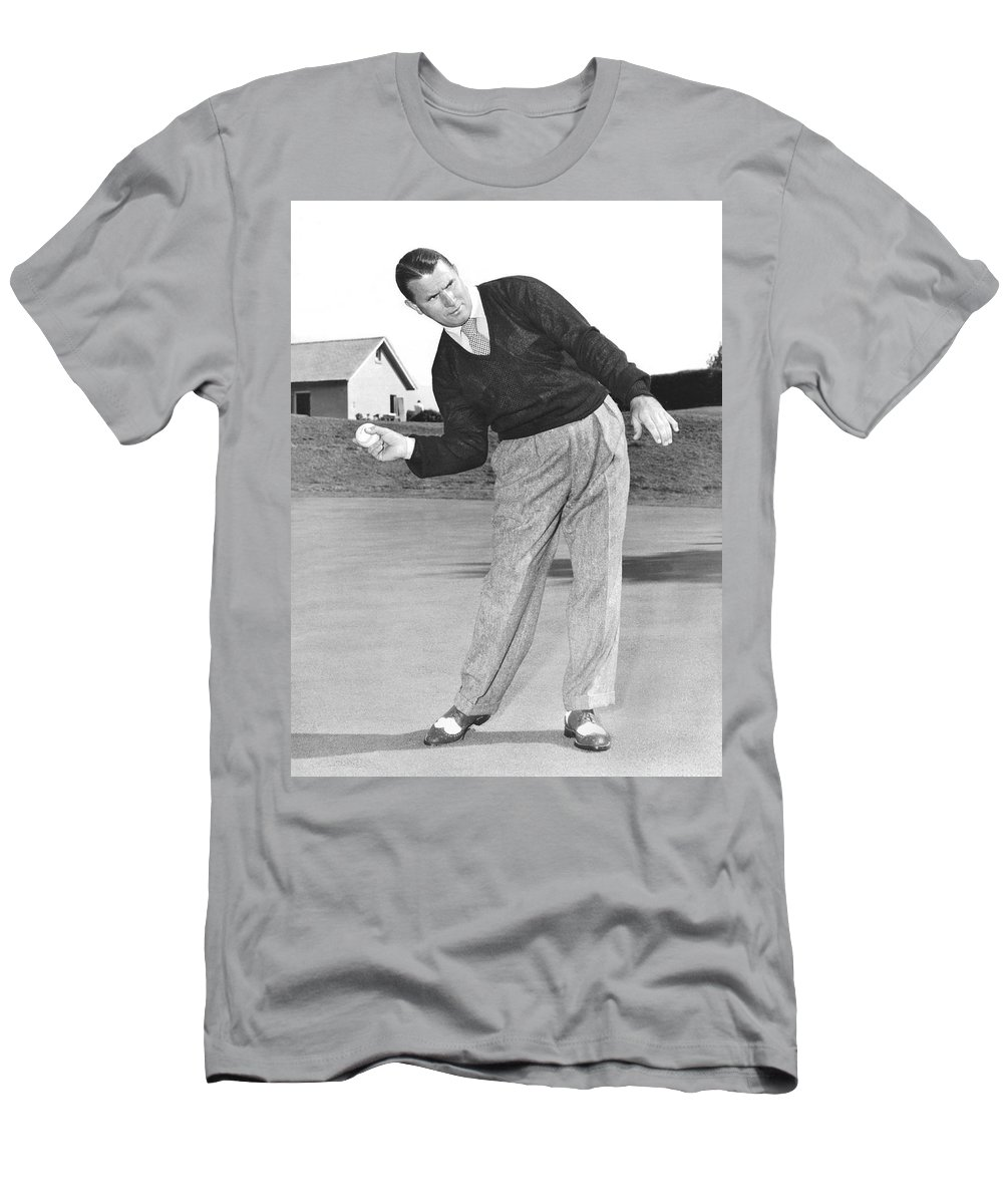1 Person Men's T-Shirt (Athletic Fit) featuring the photograph Man Posing With Sports Gear by Underwood Archives