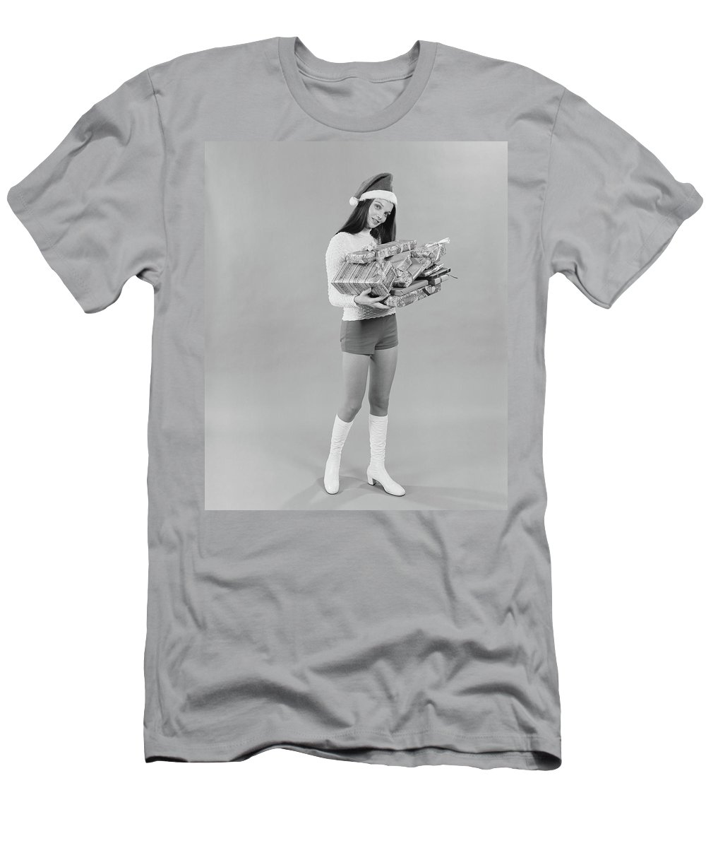 Photography Men's T-Shirt (Athletic Fit) featuring the photograph 1960s 1970s Young Woman Wearing Santa by Vintage Images