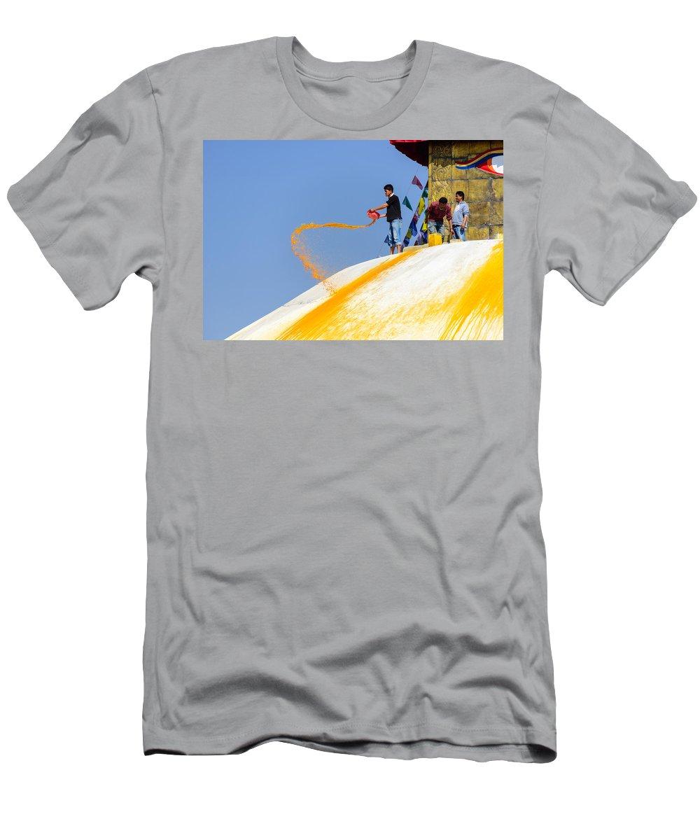 Bodnath Men's T-Shirt (Athletic Fit) featuring the photograph Man Throwing Orange Paint On Boudhanath Stupa by Dutourdumonde Photography