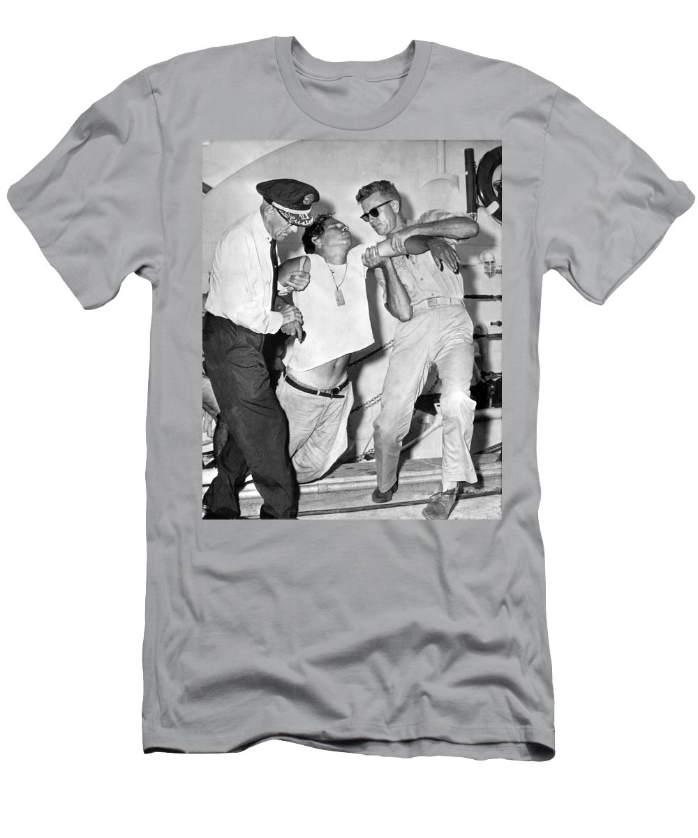 1960s Men's T-Shirt (Athletic Fit) featuring the photograph A Cuban Refugee Collapses by Underwood Archives