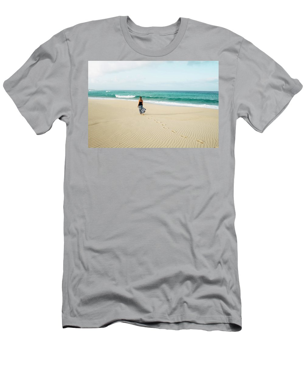 Color Image Men's T-Shirt (Athletic Fit) featuring the photograph A Girl Walks On The Beach In A Long by Sergio Villalba