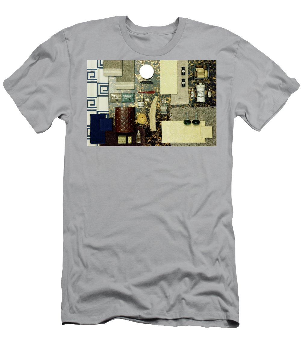 Studio Shot Men's T-Shirt (Athletic Fit) featuring the photograph A Group Of Household Items by Geoffrey Baker
