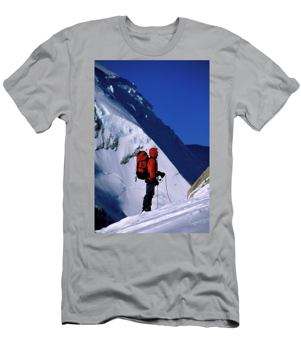 Action Men's T-Shirt (Athletic Fit) featuring the photograph A Man Mountaineering In The Alps by Corey Rich