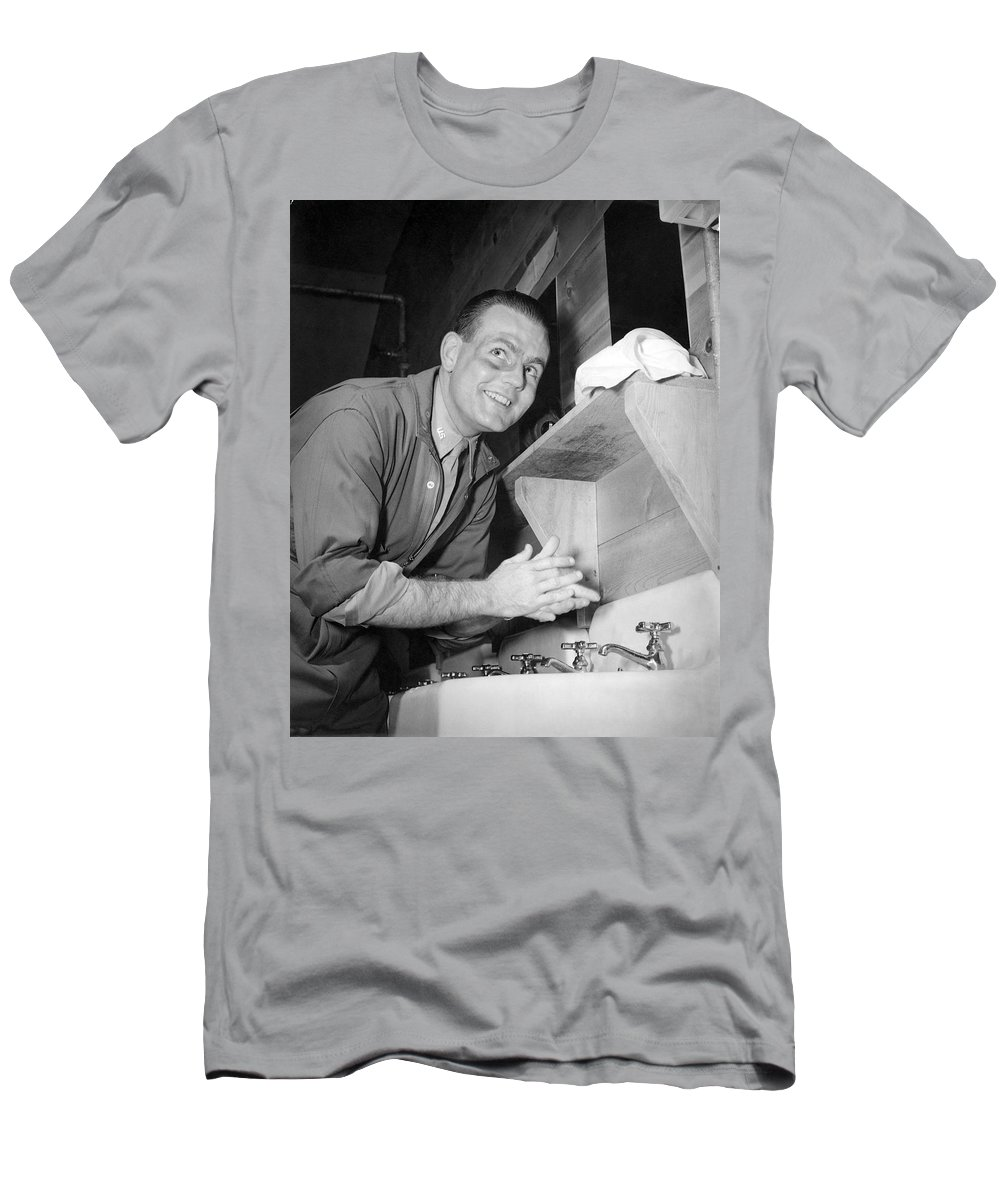 1 Person Men's T-Shirt (Athletic Fit) featuring the photograph A Man Washing His Hands by Underwood Archives