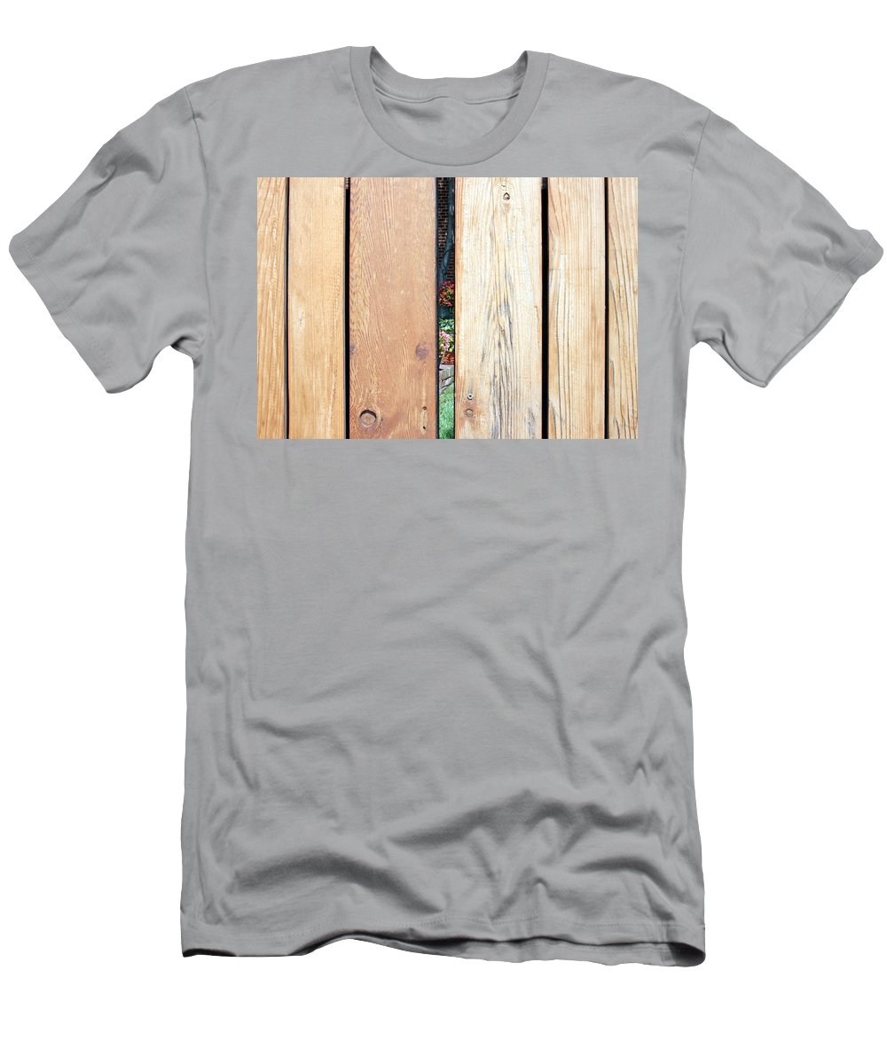 Fence Men's T-Shirt (Athletic Fit) featuring the photograph A Peek Through Wood by Cora Wandel