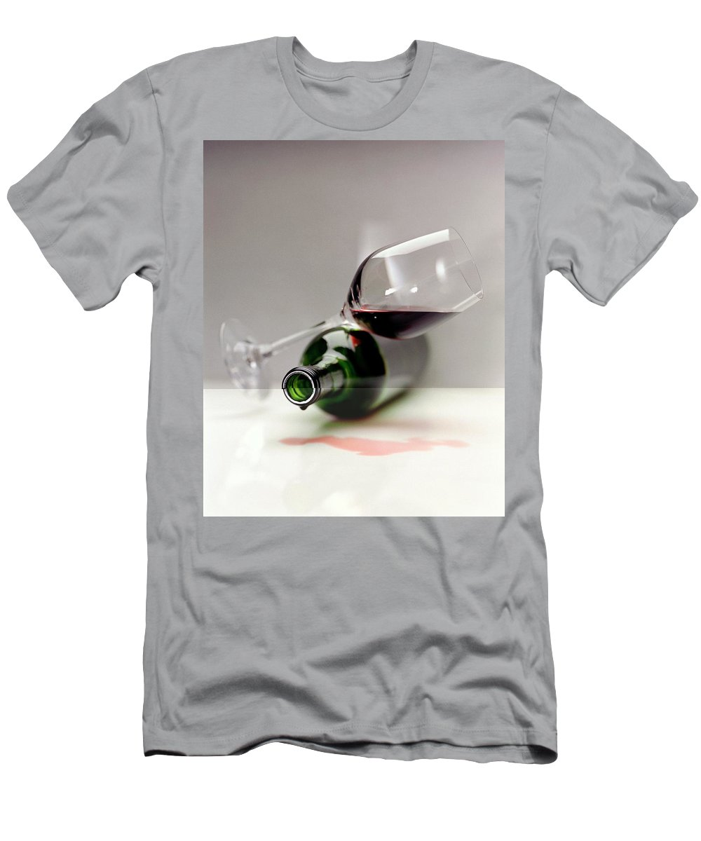 Beverage T-Shirt featuring the photograph A Wine Bottle And A Glass Of Wine by Romulo Yanes