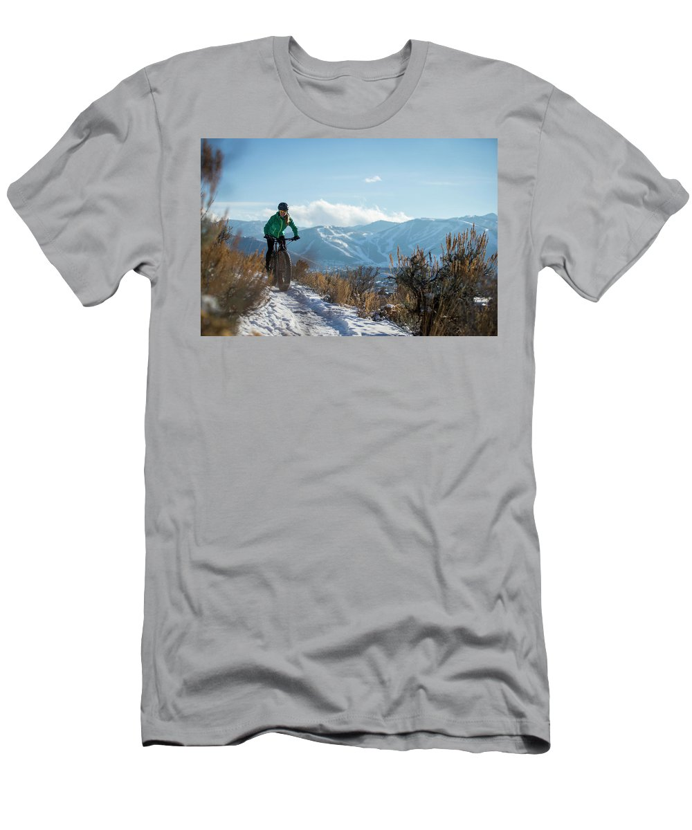 Cloud Men's T-Shirt (Athletic Fit) featuring the photograph A Woman Fat Biking On The Trails by Mike Schirf