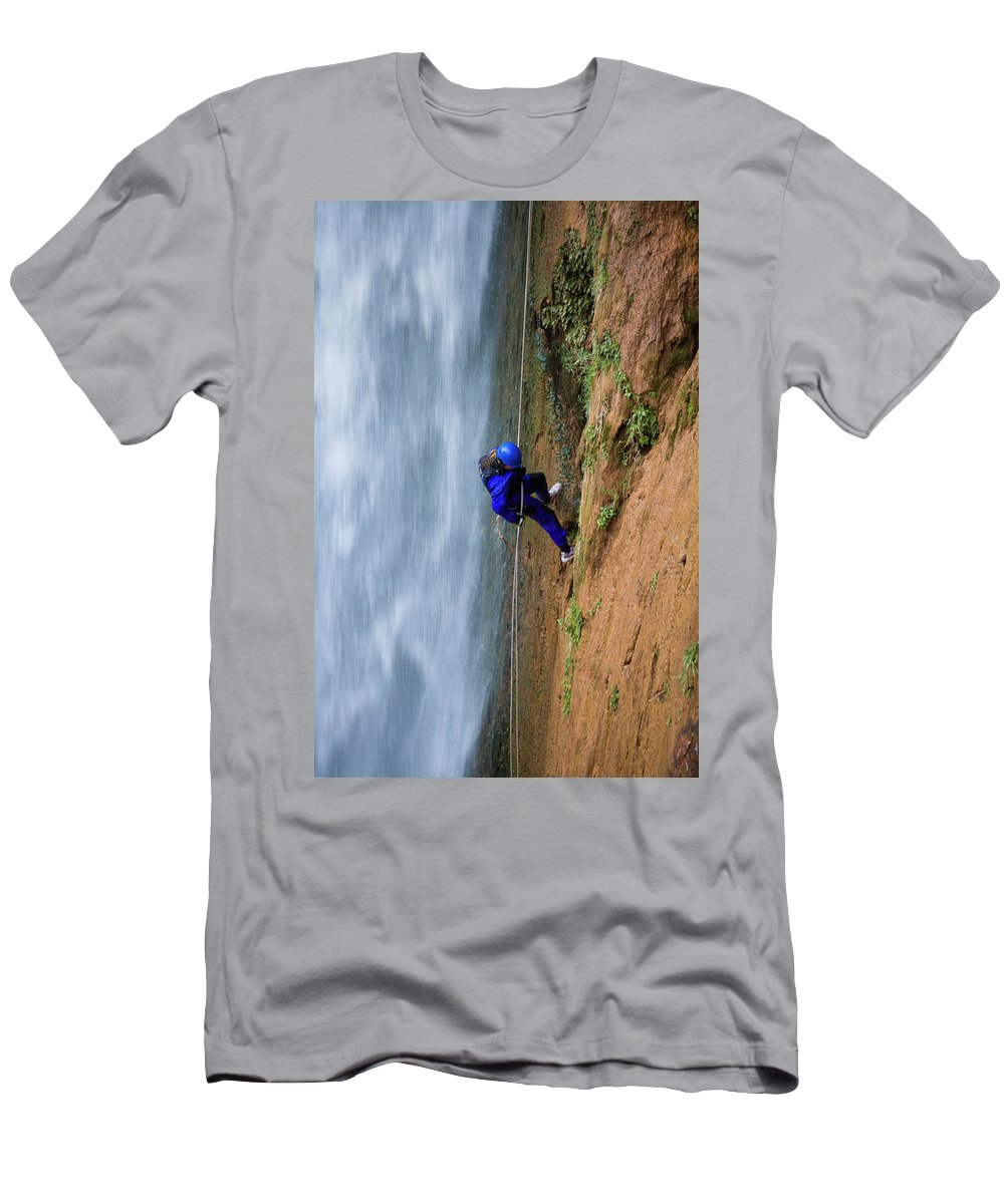 Adventure Men's T-Shirt (Athletic Fit) featuring the photograph A Woman Rappelling Down Next To Deer by Whit Richardson