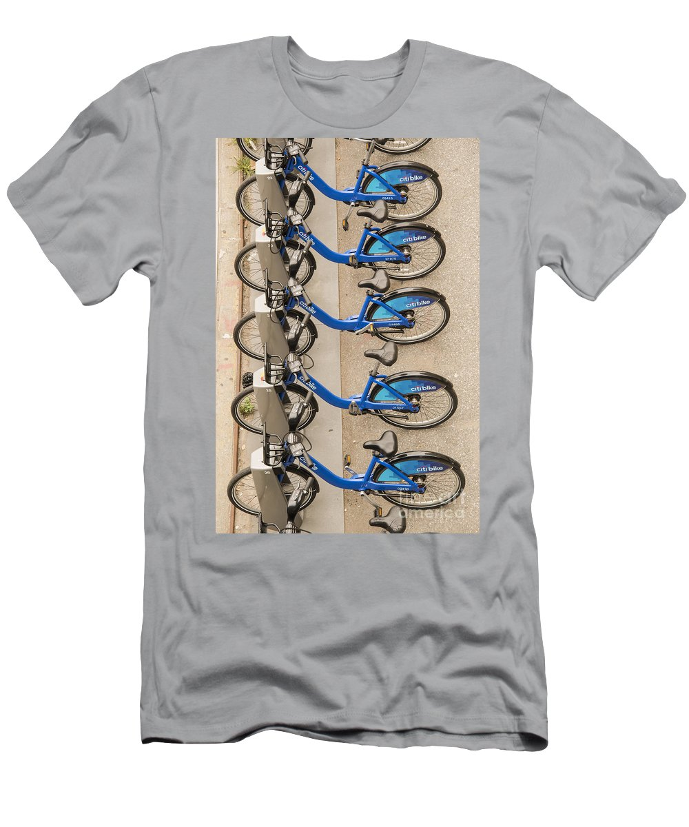 Blue City Bike Bikes Bicycle Rental Bicycles Wheel Wheels Cities Cityscape Cityscapes Public Transportation New York City Men's T-Shirt (Athletic Fit) featuring the photograph Blue City Bikes by Bob Phillips