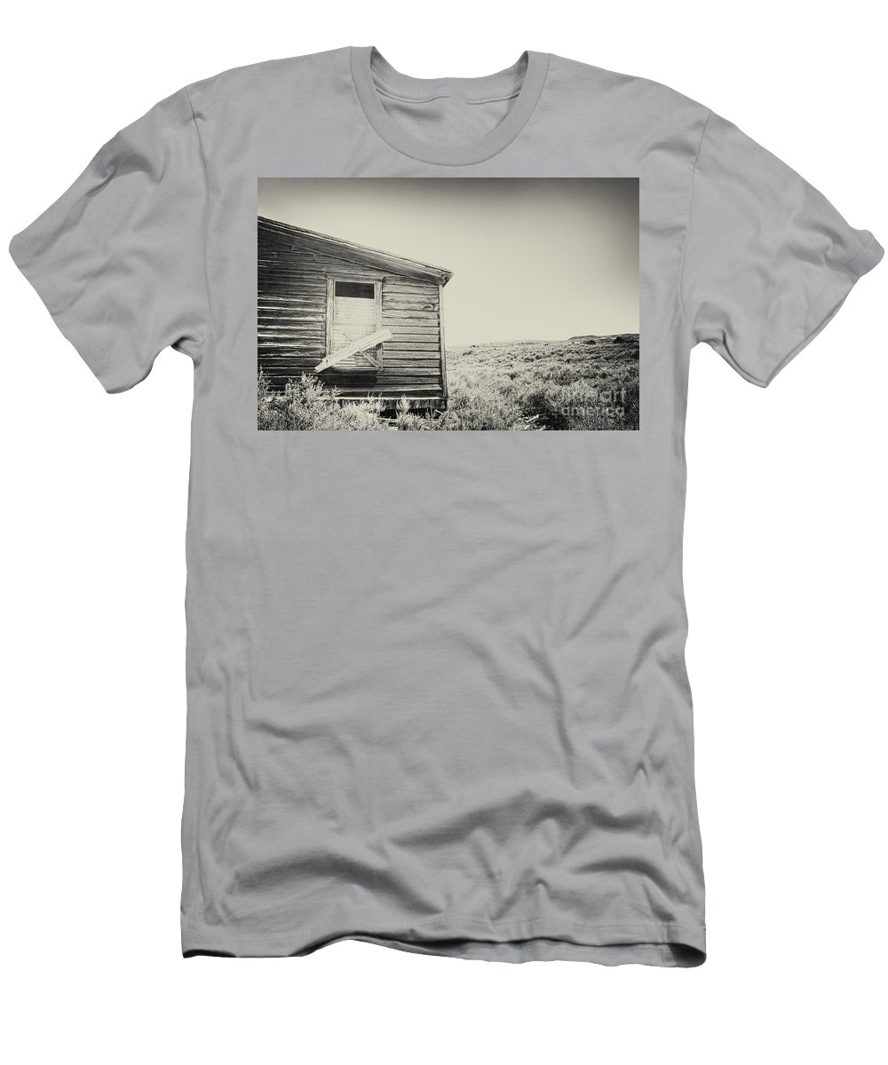 Structure; Wood; Wooden; Country; Countryside; Desert; Deserted; Worn; Abandoned; Boards; Ruins; Boarded Up; Grasses; Hills; House; Home; Sepia; Rural; Vast; Dirt; Window; Sky; Vintage; Antique Men's T-Shirt (Athletic Fit) featuring the photograph Boarded by Margie Hurwich