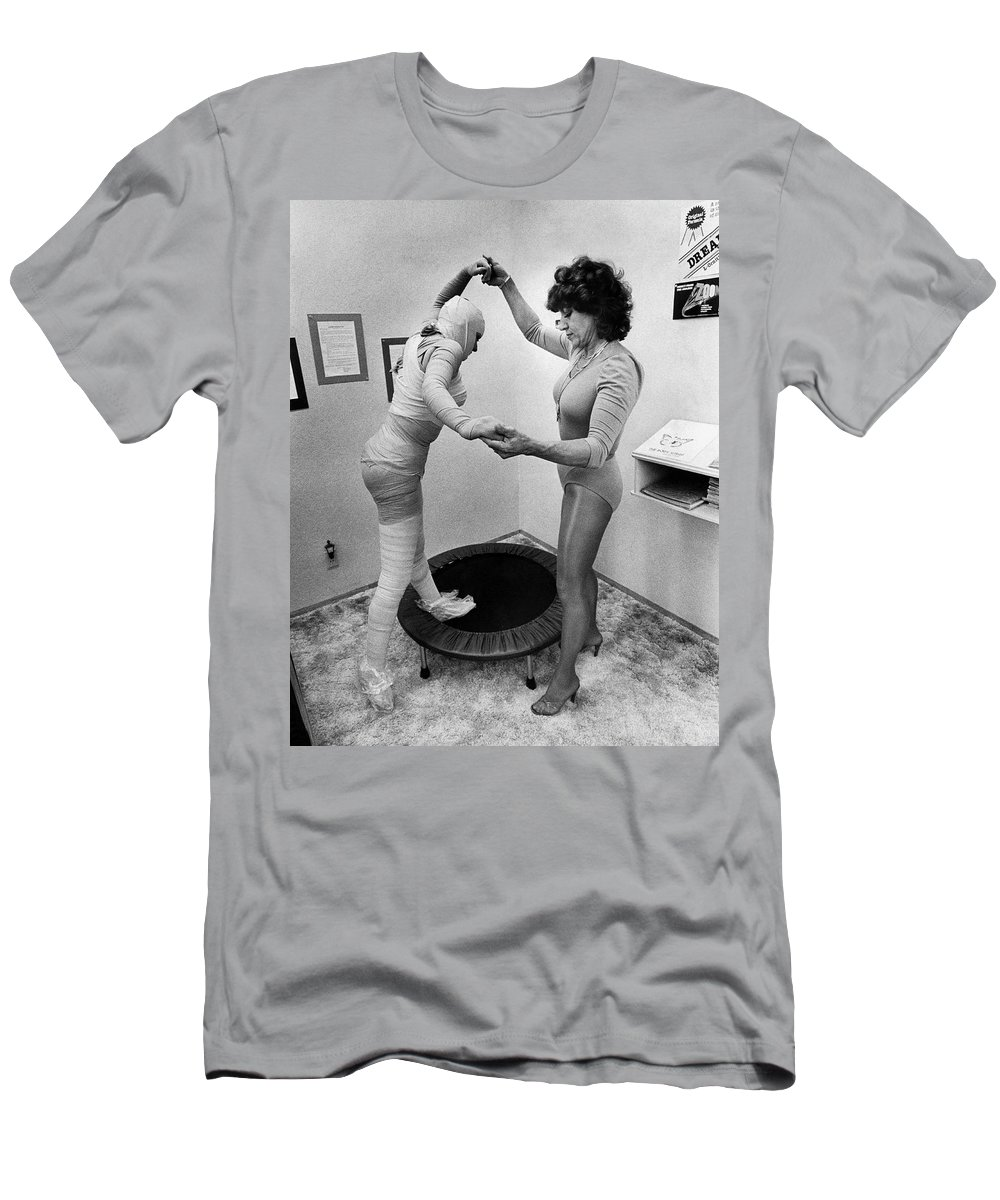 1960s Men's T-Shirt (Athletic Fit) featuring the photograph Body Wrap Exercise by Underwood Archives