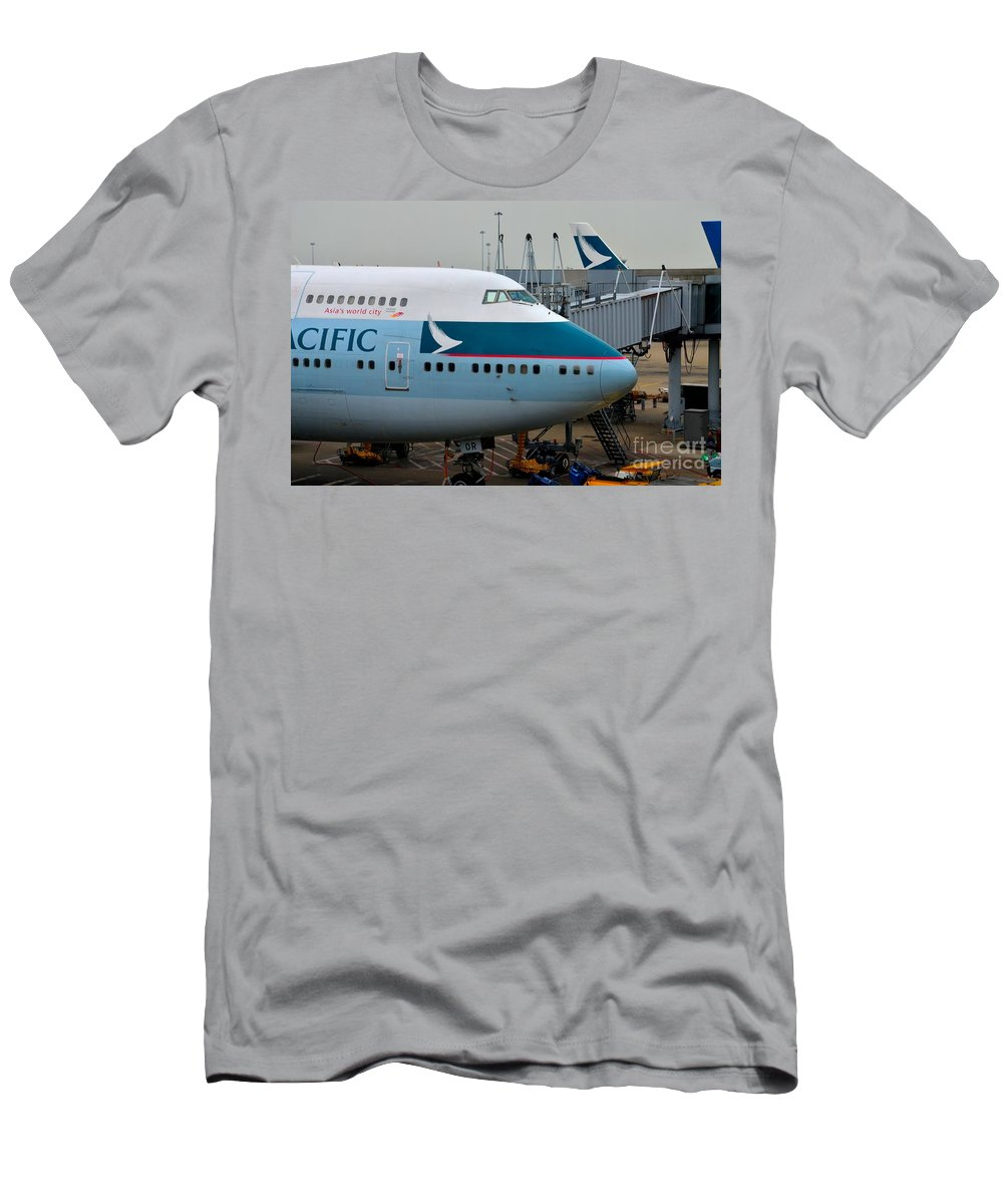 Cathay Pacific Men's T-Shirt (Athletic Fit) featuring the photograph Cathay Pacific 747 Jumbo Jet Parked At Hong Kong Airport by Imran Ahmed