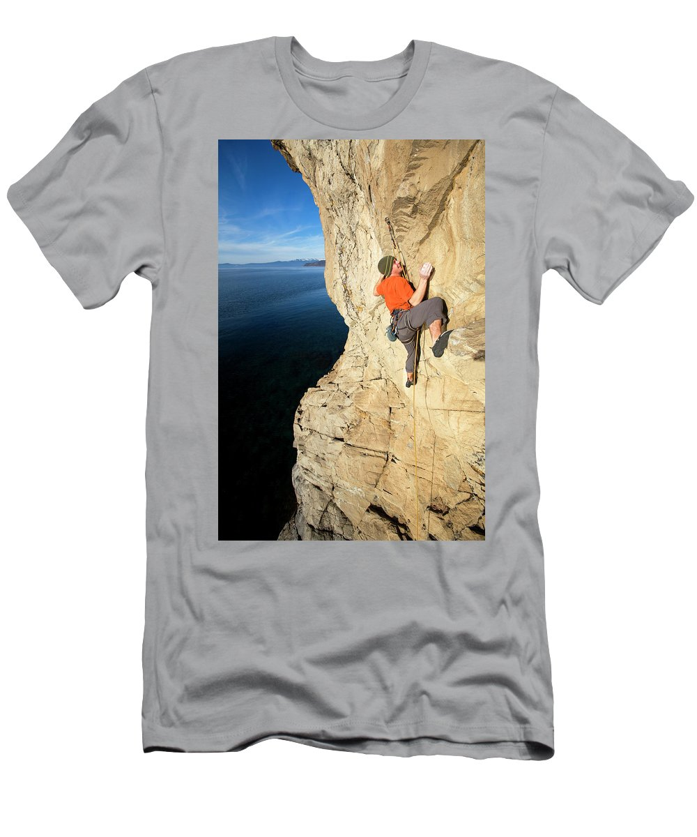 Action Men's T-Shirt (Athletic Fit) featuring the photograph Climber Reaches For Hand Hold by Corey Rich