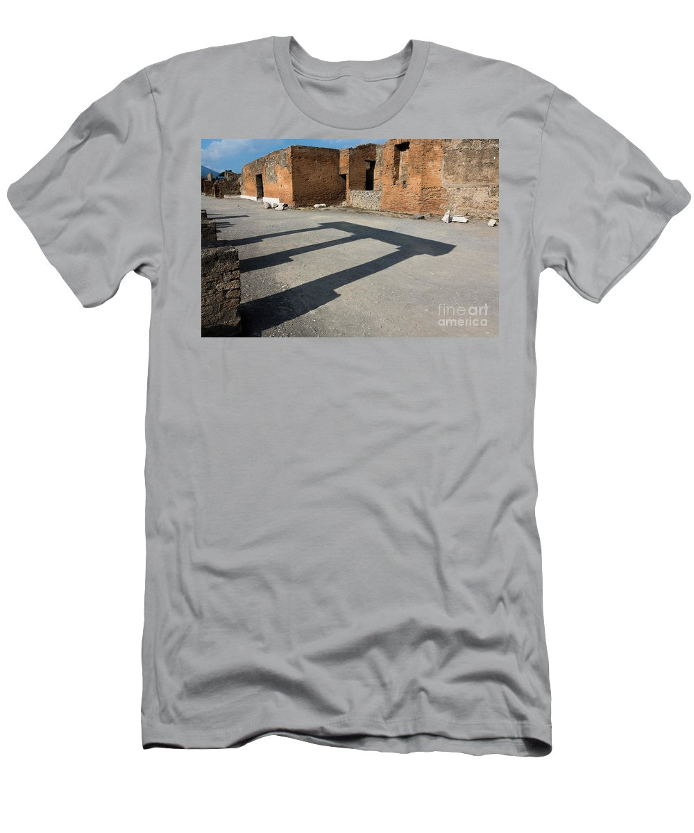 Abandoned Men's T-Shirt (Athletic Fit) featuring the photograph Column Shadows Forum At Pompeii Italy by Dan Hartford